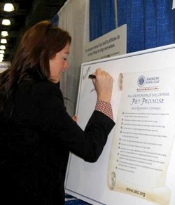 Kelly Magee signing the RDO Pet Promise